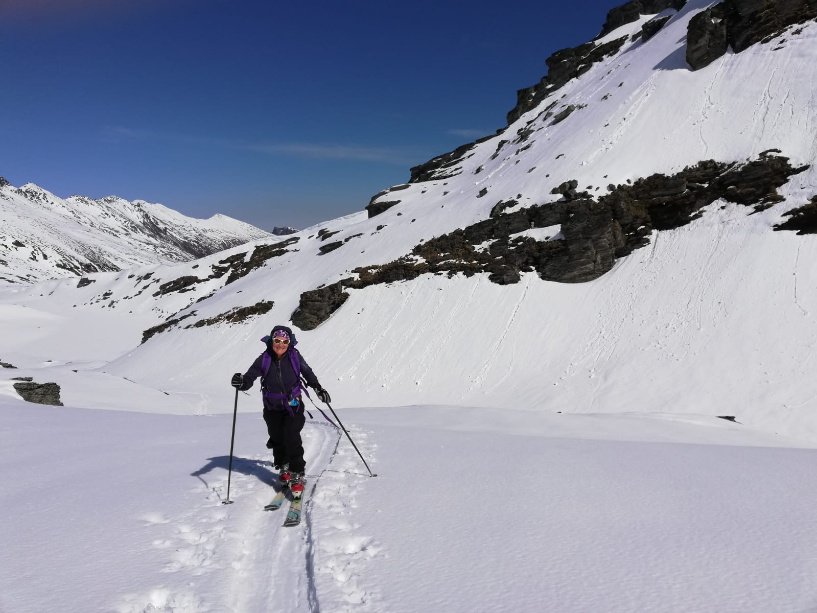 Skinning back up to curvy basin saddle on recent day Ski tour  @ Remarkables. photo credit : Sue Notley